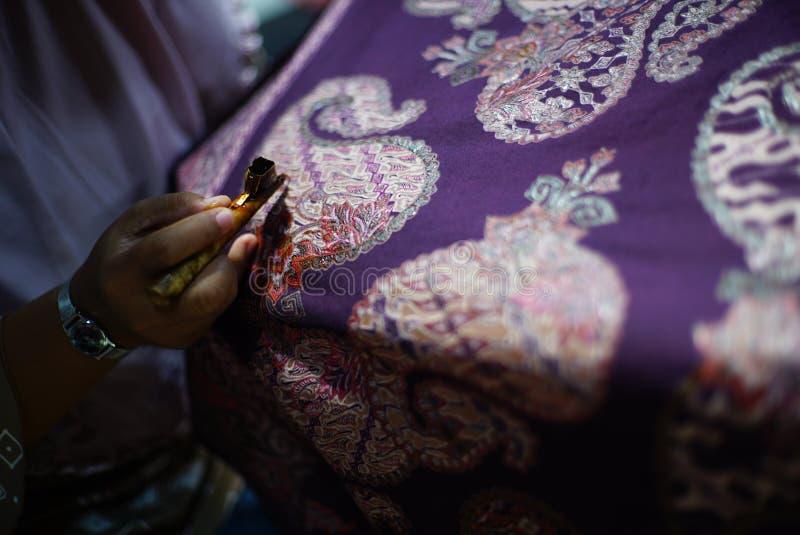 在织品的图画蜡染布Tulis 库存照片