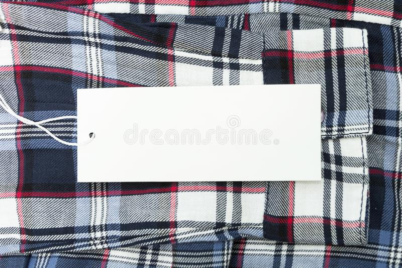 在织品的白色空标识符与一个方形的样式 o 库存照片