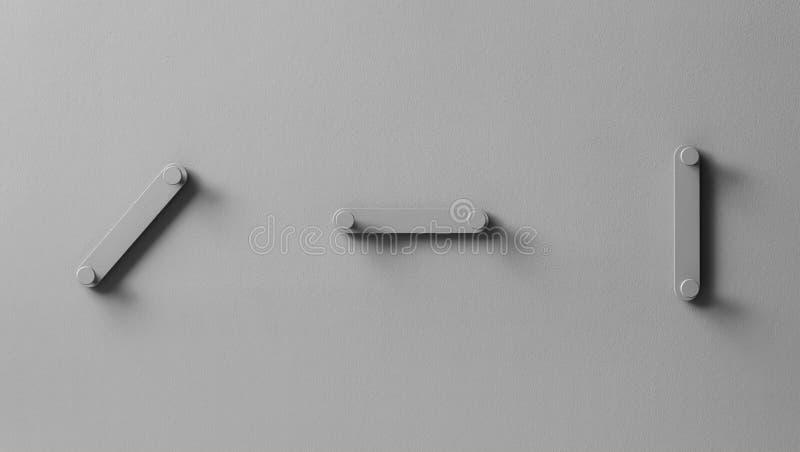 在织地不很细墙壁上的花梢灰色金属挂衣架在演播室 免版税库存照片