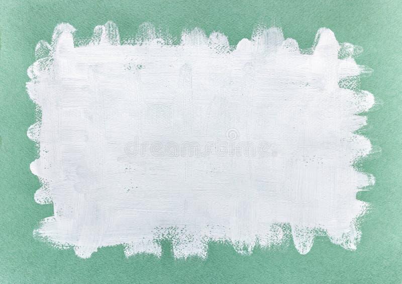 在绿皮书的摘要手拉的白色丙烯酸漆 库存照片