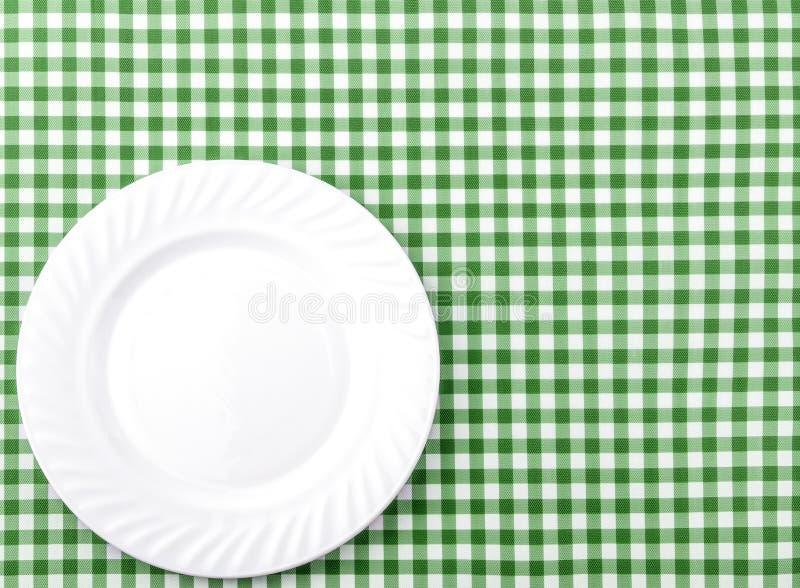 在绿色和白色方格的织品桌布Backg的白色板材 库存图片