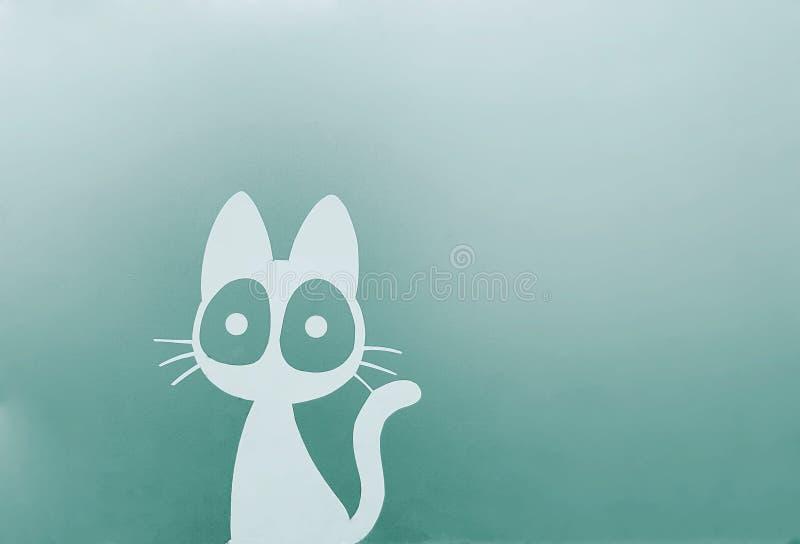 在绿色墙壁上的逗人喜爱的猫字符贴纸 库存图片