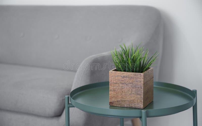 在绿色金属现代桌上的木立方体植物罐 免版税库存照片