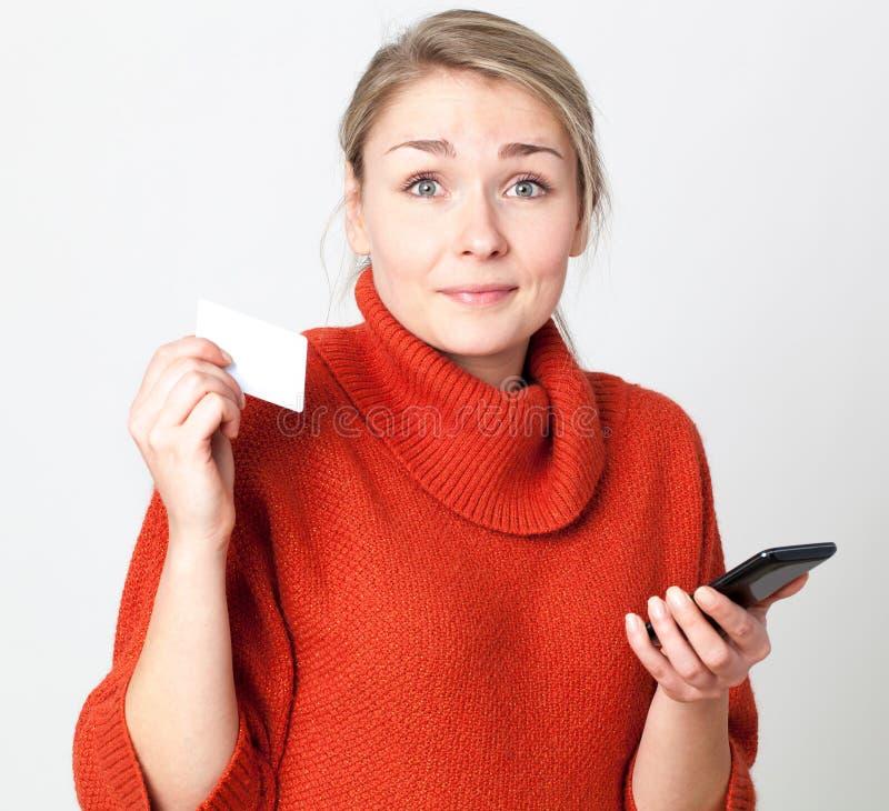 在网上支付惊奇的少妇的流动商务 库存图片