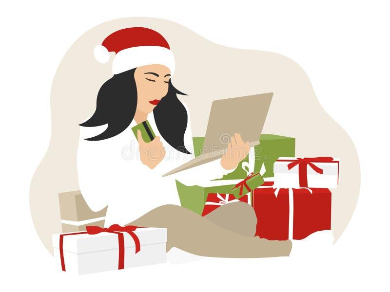 在网上购物与信用或借记卡的妇女圣诞节 皇族释放例证