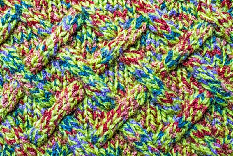 在羊毛衣裳的被编织的样式,背景,墙纸 免版税库存图片