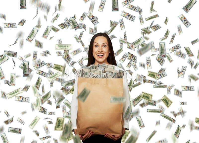 在美元的雨下的女实业家 免版税库存照片