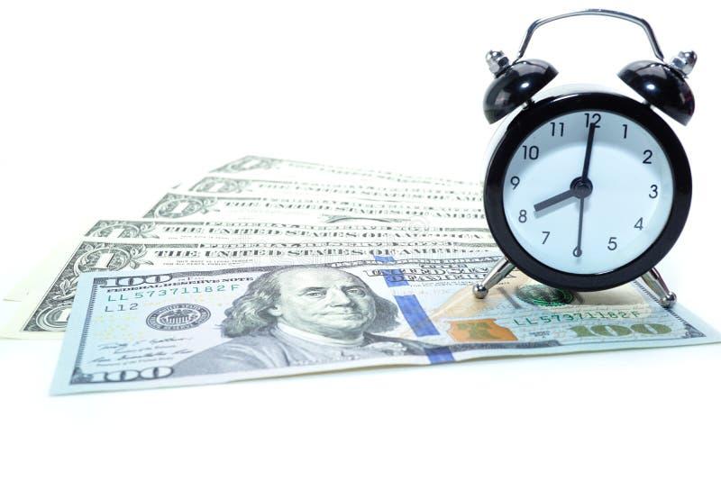 在美元钞票的闹钟:银行帐户,投资分析研究数据经济,贸易,商业公司 免版税库存图片