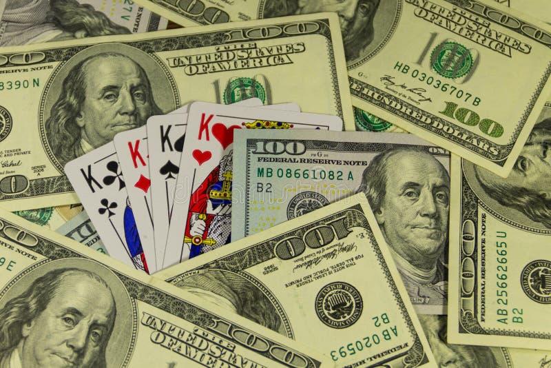 在美国人的纸牌一百元钞票背景 免版税库存照片