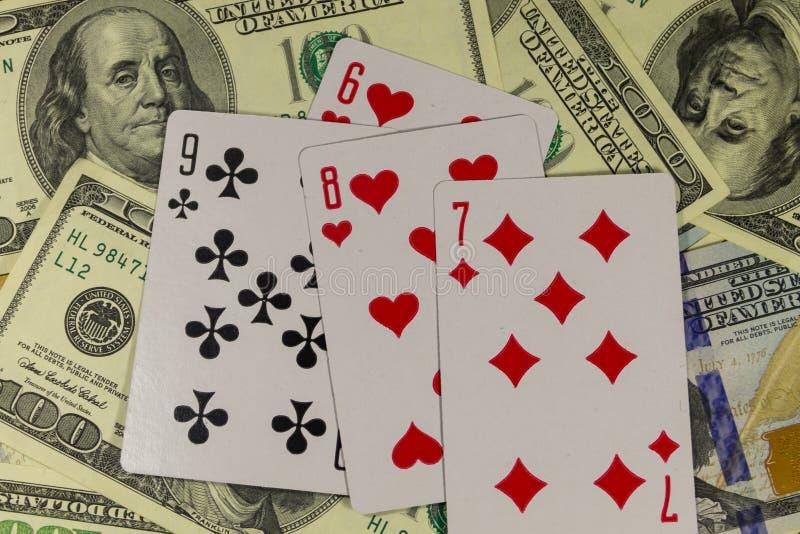 在美国人的纸牌一百元钞票背景 免版税库存图片