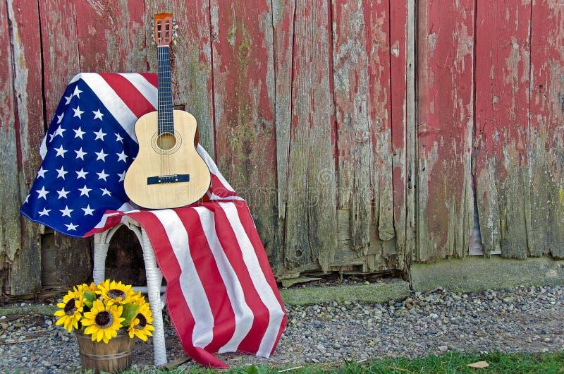 在美国国旗的吉他 免版税库存图片