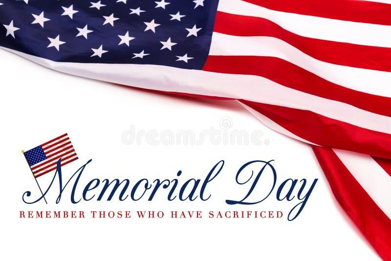 在美国国旗背景的文本阵亡将士纪念日 免版税库存图片