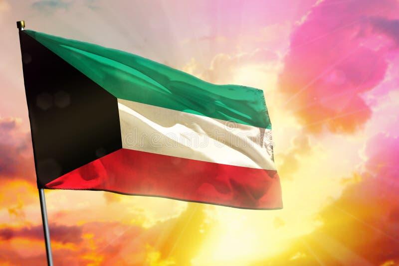 在美好的五颜六色的日落或日出背景的振翼的科威特旗子 : 库存照片