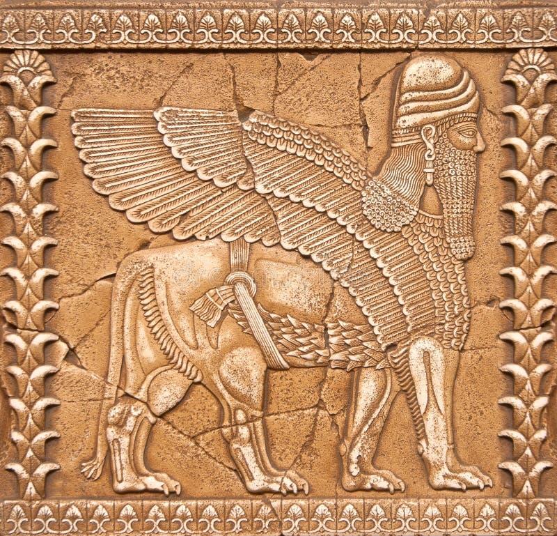 在美索不达米亚mitology的石雕刻的Lamassu或Shedu 免版税库存照片