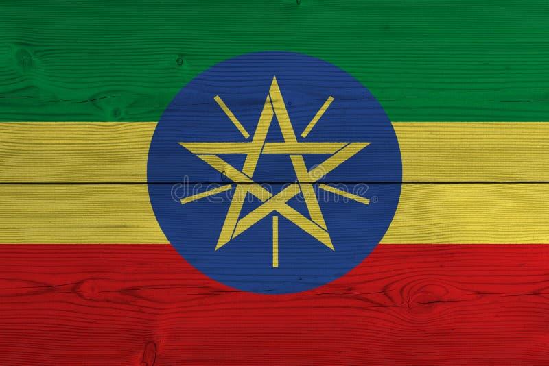 在老木板条绘的埃塞俄比亚旗子 库存例证
