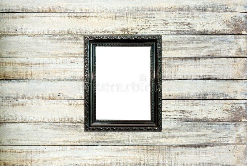 在老木背景的黑色葡萄酒画框 免版税库存照片