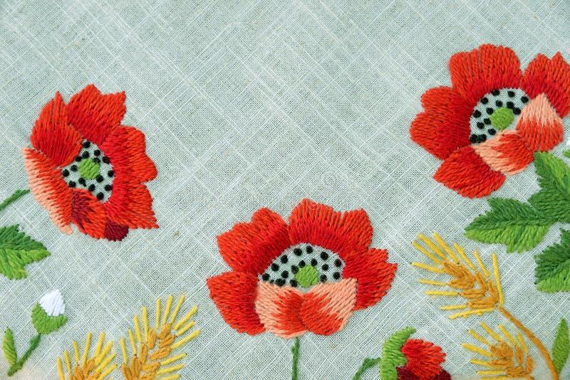 在老牌的绣花织物纹理 免版税库存照片
