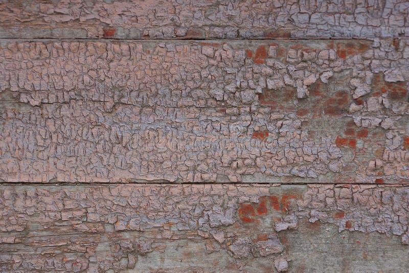 在老破旧的油漆的布朗木板条纹理 免版税库存图片