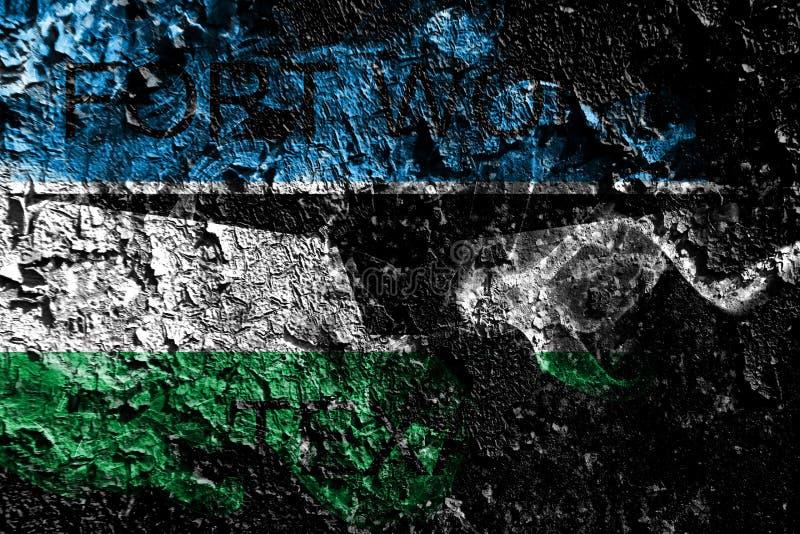 在老肮脏的墙壁背景的沃斯堡,得克萨斯发烟性神秘的旗子 皇族释放例证