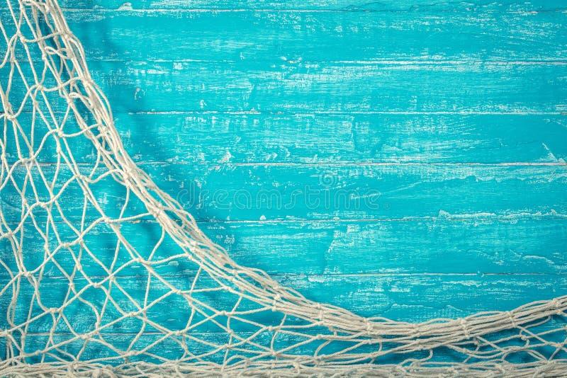 在老蓝色委员会的捕鱼网 免版税库存图片