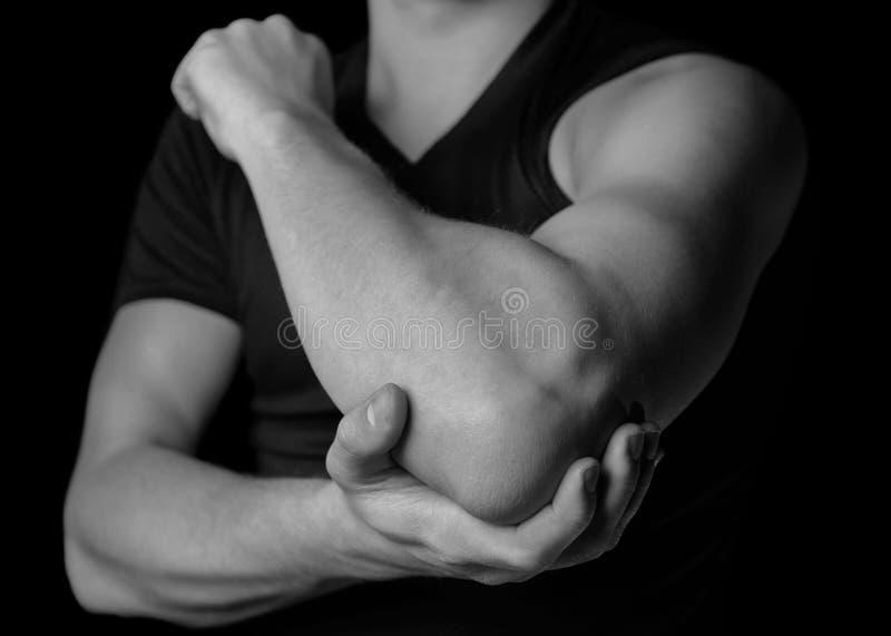 在肘关节的痛苦 图库摄影
