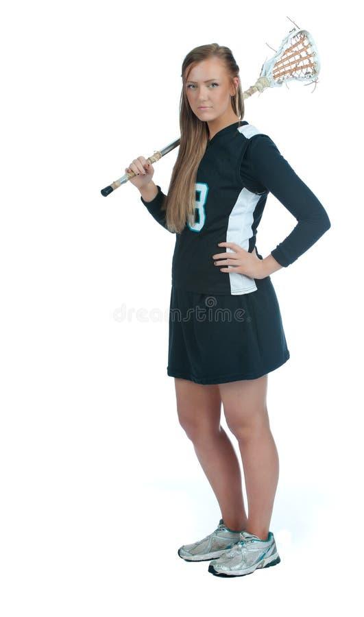 在肩膀常设棍子的女孩曲棍网兜球 图库摄影