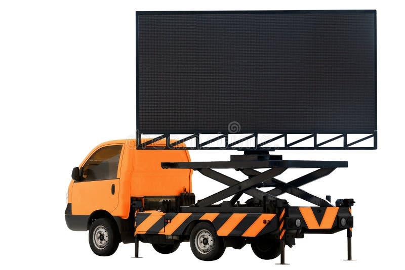 在背景白色标志广告的隔绝的汽车橙色颜色LED盘区的广告牌 库存图片