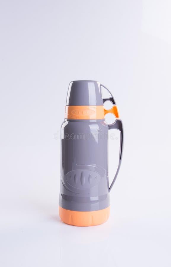 在背景的热或热烧瓶 免版税库存图片