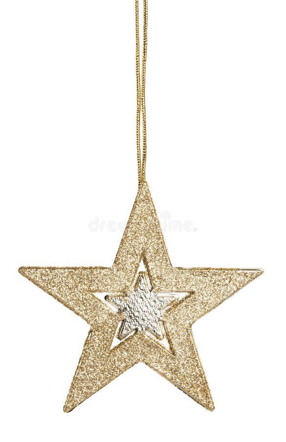 在背景的金黄圣诞节星装饰 免版税库存照片