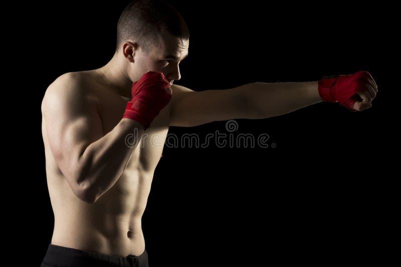 在脚踢拳击训练 库存照片