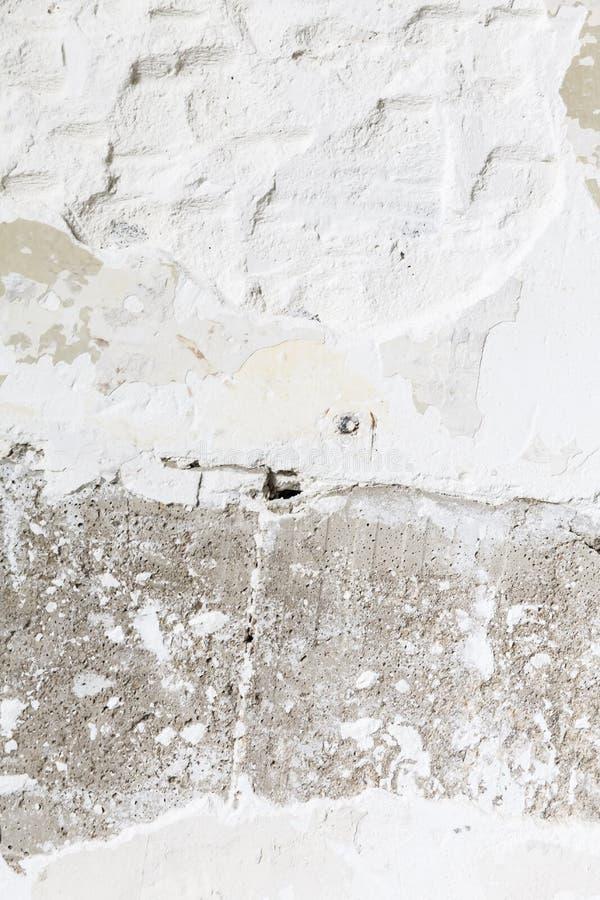 在膏药墙壁上的镇压孔 免版税图库摄影