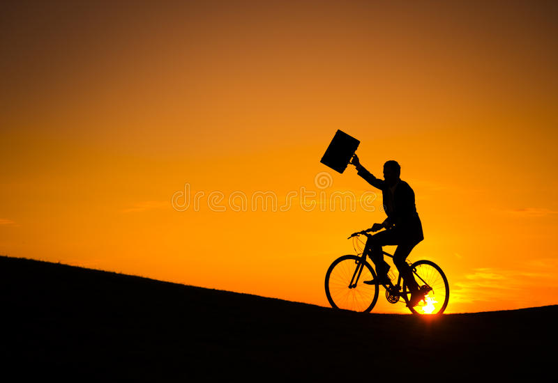 在自行车的商人 免版税库存图片