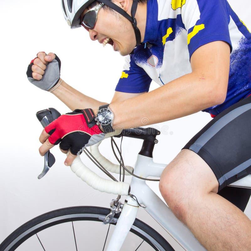 在自行车的Cycler骑马 免版税库存照片