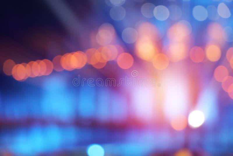 在舞台背景的抽象多彩多姿的光 免版税库存照片