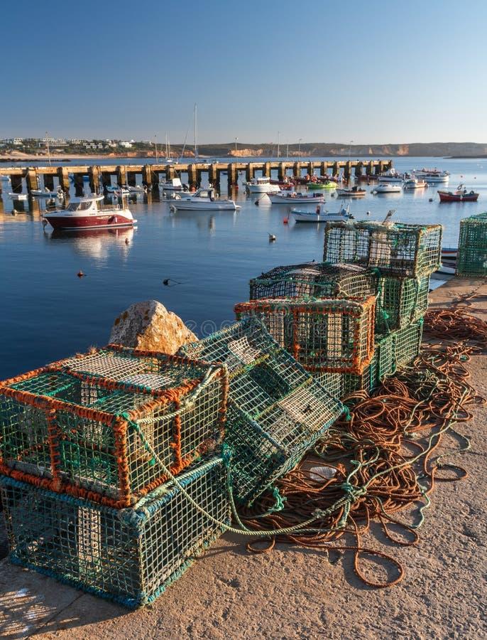 在船坞的渔夫捕鱼网 免版税库存照片