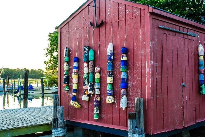 在船库的渔浮体小游艇船坞的 库存照片