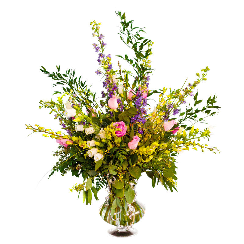 在花瓶的五颜六色的花花束排列 免版税库存照片