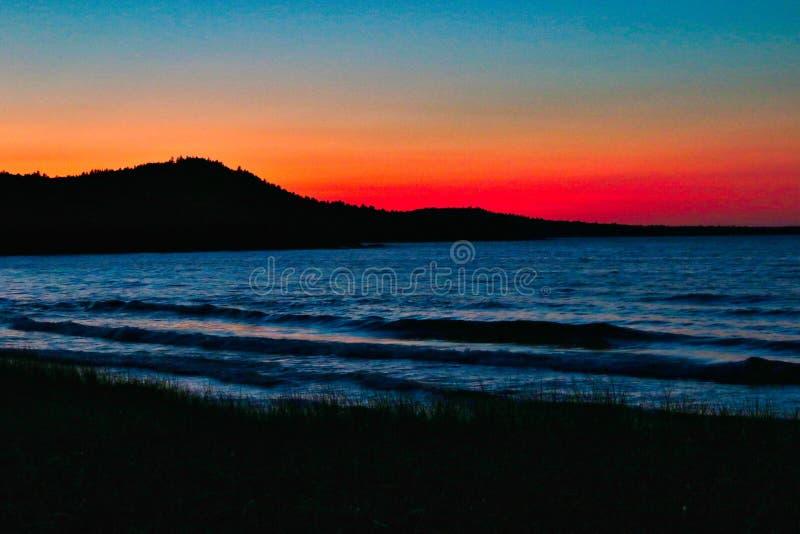 在苏必利尔湖, Marquette,密执安,美国的日落 库存照片