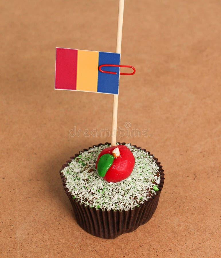 在苹果杯形蛋糕的旗子 库存图片