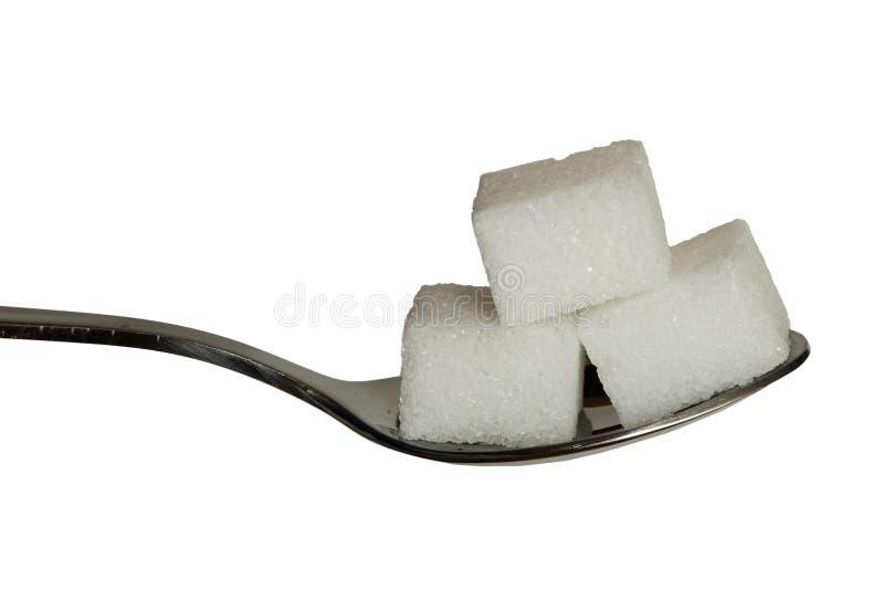 在茶匙的糖cobes 图库摄影