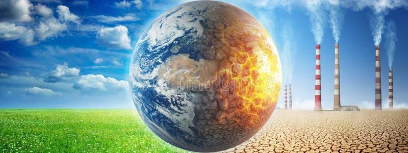 在草和云彩背景的地球对在一片死的沙漠的背景的被破坏的地球有抽烟的烟囱的  免版税图库摄影