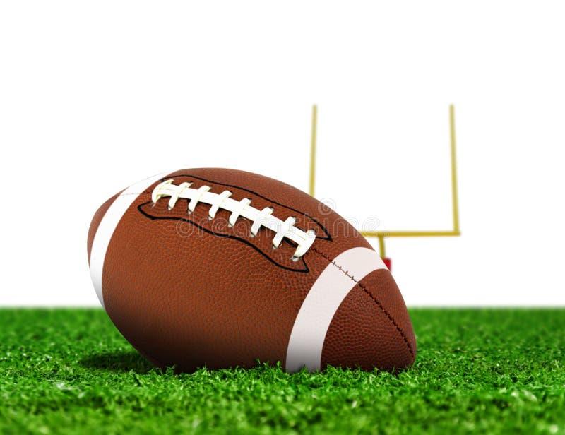 在草的橄榄球球与目标岗位 免版税库存照片