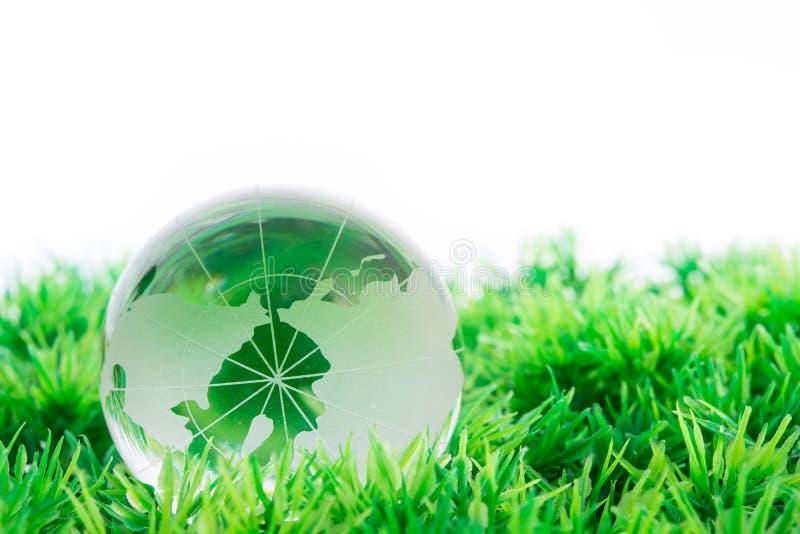 在草的玻璃地球 库存图片