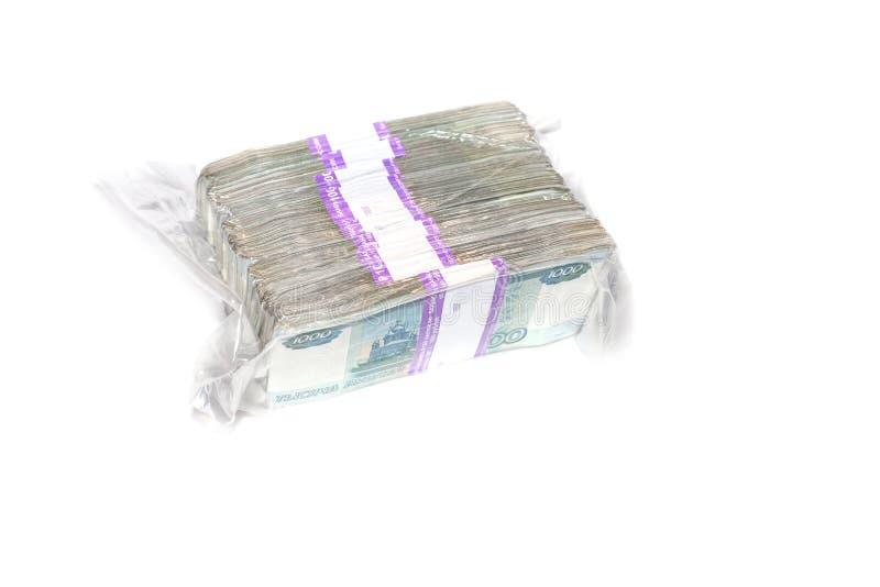 在获得抽奖的金钱的一千个票据被包装的概念的一百万俄罗斯卢布 免版税库存图片