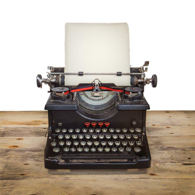 在葡萄酒木楼层上的老打字机 库存照片