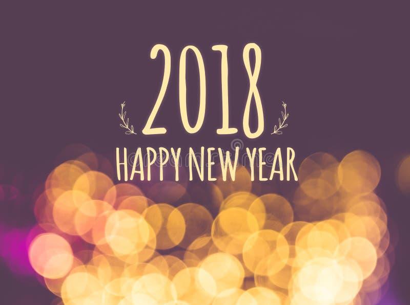 在葡萄酒迷离欢乐bokeh光backgrou的2018新年好 免版税图库摄影