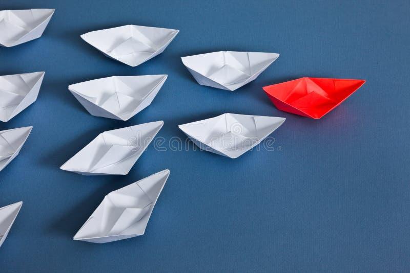 在蓝纸的纸小船 免版税图库摄影