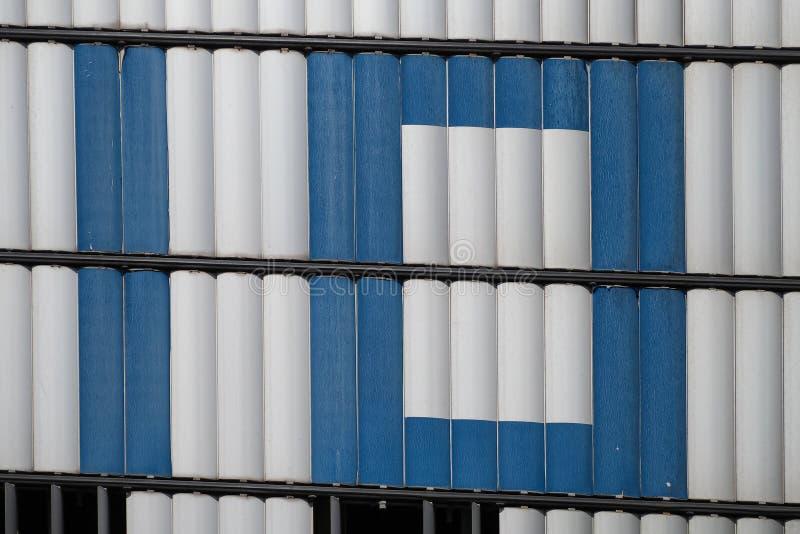 在蓝色信件的第十在白合金 图库摄影