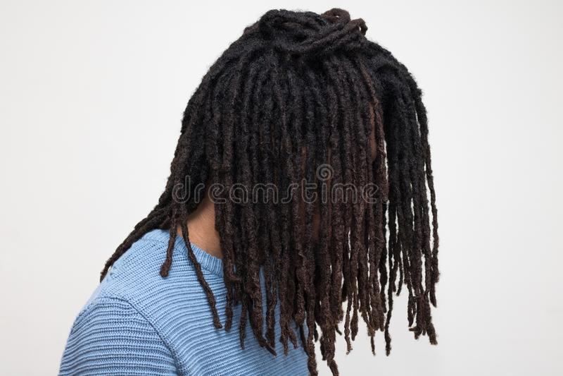 在蓝色毛线衣的头发 库存照片