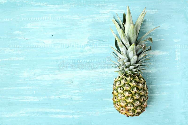 在蓝色淡色背景的菠萝 库存图片